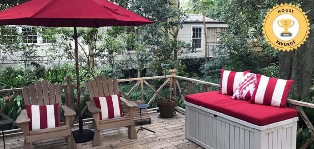 Bold Cherry Red Patio Accents Pop on Rustic Deck